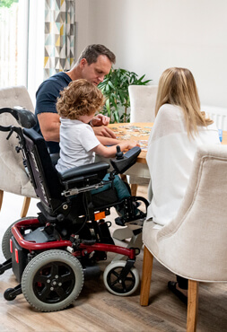 young parents with special needs son in wheelchair